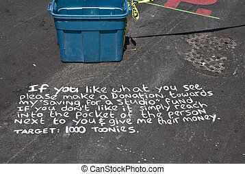 Writing by a street artist on a road in Toronto