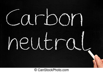 Writing Carbon neutral on a blackboard.
