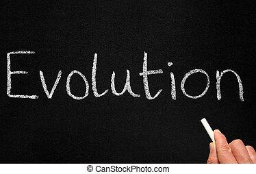 Writing evolution. - A teacher writing evolution on a...