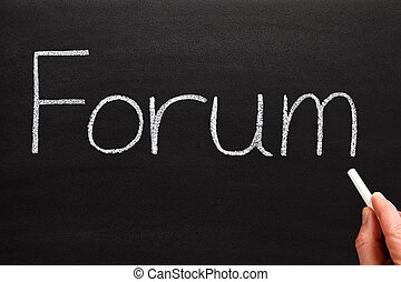 Writing forum with white chalk on a blackboard.