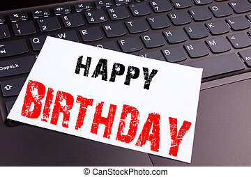 Writing Happy Birthday text made in the office close-up on laptop computer keyboard. Business concept for Anniversary Celebration Workshop on the black background with copy space