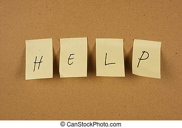 writing help is spelled in a sheet of paper affixed to the wall brown carton