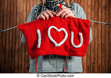 Writing I Love You on knitting with needlework. Valentines day concept.