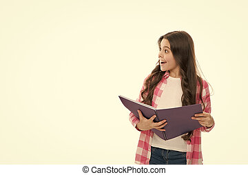 Writing making notes. School routine. Educational process. Little girl with writing pad. Cute small school child hold open note pad white background copy space. Useful pad. School stationery concept