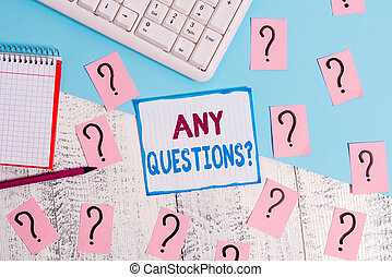 Writing note showing Any Questions Question. Business photo showcasing you say write order to ask demonstrating about something Writing tools and scribbled paper on top of the wooden table.