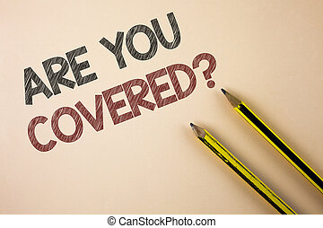 Writing note showing  Are You Covered Question. Business photo showcasing asking about you insurance health statement written on Plain background Pencils next to it.