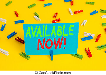 Writing note showing Available Now. Business photo showcasing you can find it obtain or operable at this current moment Colored clothespin papers empty reminder yellow floor background office.