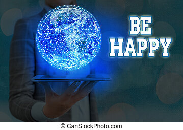 Writing note showing Be Happy. Business concept for to be display pleasure and contentment over a particular thing or event Elements of this image furnished by NASA