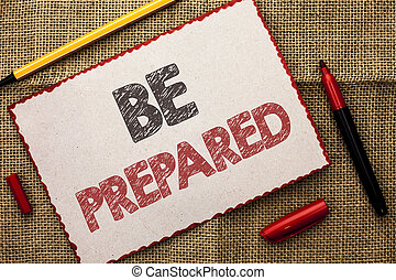 Writing note showing  Be Prepared. Business photo showcasing Preparedness Challenge Opportunity Prepare Plan Management written on Cardboard Piece on the jute background Markers next to it.