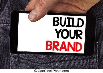 Writing note showing Build Your Brand. Business photo...