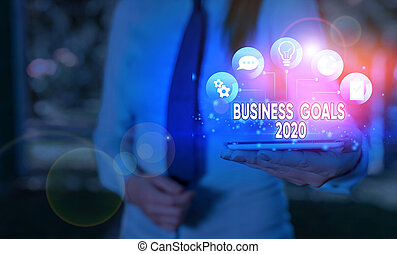 Writing note showing Business Goals 2020. Business concept for Advanced Capabilities Timely Expectations Goals