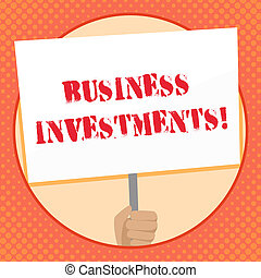Writing note showing Business Investments. Business photo showcasing act of committing money or capital to an endeavor Hand Holding Placard Supported by Handle Social Awareness.