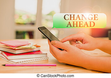 Writing note showing Change Ahead. Business photo showcasing to replace with or exchange for another Become different woman using smartphone and technological devices inside the home.