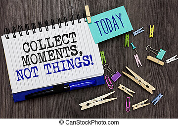 Writing note showing Collect Moments, Not Things. Business photo showcasing Happiness philosophy enjoy simple life facts Different paperclip on woody table pinch on written notepad blue pen
