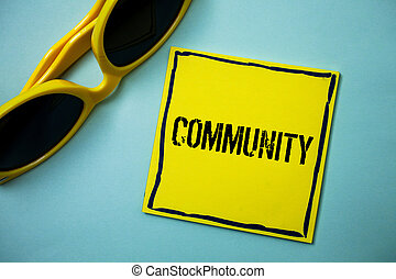 Writing note showing Community. Business photo showcasing Neighborhood Association State Affiliation Alliance Unity Group Ideas messages blue background sunglasses casual annotations thoughts.