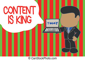 Writing note showing Content Is King. Business photo showcasing believe that content is central to the success of a website Standing professional businessman holding open laptop right hand side.