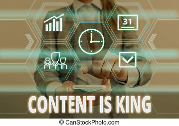 Writing note showing Content Is King. Business photo showcasing believe that content is central to the success of a website Woman wear formal work suit presenting presentation using smart device.