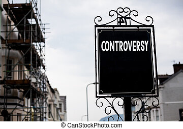 Writing note showing Controversy. Business photo showcasing Disagreement or Argument about something important to people Vintage black board sky old city ideas scaffolding landscapes antique.