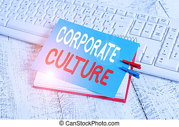 Writing note showing Corporate Culture. Business concept for pervasive values and attitudes that characterize a company notebook reminder clothespin with pinned sheet light wooden
