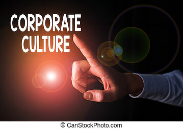 Writing note showing Corporate Culture. Business concept for pervasive values and attitudes that characterize a company Finger pointing in the Dark with hand pointing in the copy space