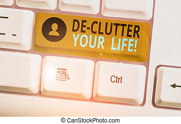 Writing note showing De Clutter Your Life. Business concept for remove unnecessary items from untidy or overcrowded places