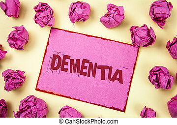 Writing note showing  Dementia. Business photo showcasing Long term memory loss sign and symptoms made me retire sooner written on Pink Sticky Note Paper on plain background Pink Paper Balls.