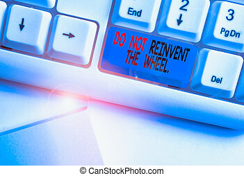 Writing note showing Do Not Reinvent The Wheel. Business ...