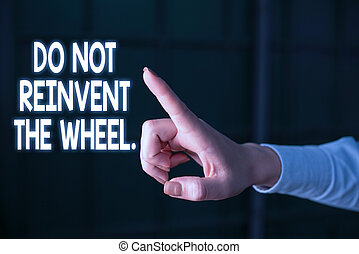 Writing note showing Do Not Reinvent The Wheel. Business concept for stop duplicating a basic method previously done Finger pointing in the Dark with hand pointing in the copy space