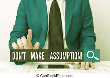 Writing note showing Don T Make Assumption. Business photo showcasing something that you assume to be case even without proof Businessman with pointing finger in front of him.