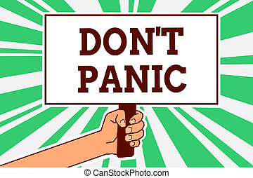 Writing note showing Don t not Panic. Business photo showcasing sudden strong feeling of fear prevents reasonable thought Man hand holding poster important protest message green ray background.