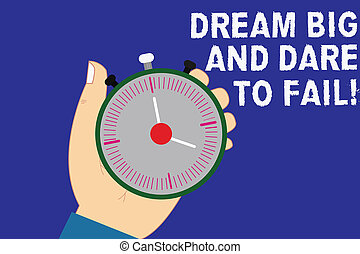 Writing note showing Dream Big And Dare To Fail. Business photo showcasing Motivation inspiration prepare to make mistakes Hu analysis Hand Holding Stop Watch Timer with Start Stop Button.