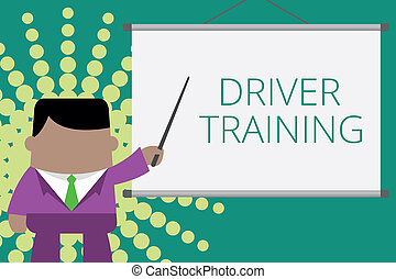 Writing note showing Driver Training. Business photo showcasing prepares a new driver to obtain a driver s is license Businessman standing in front projector screen pointing project idea.
