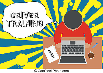 Writing note showing Driver Training. Business photo showcasing prepares a new driver to obtain a driver s is license Upper view young man sitting table laptop documents coffee cup pen.