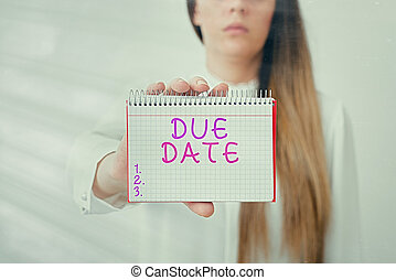 Writing note showing Due Date. Business photo showcasing the day or date by which something is supposed to be done or paid Model displaying different empty color notepad mock-up for writing idea.