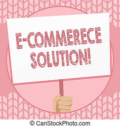 Writing note showing E Commerce Solution. Business photo showcasing Software used by business in selling products online Hand Holding Placard Supported by Handle Social Awareness.