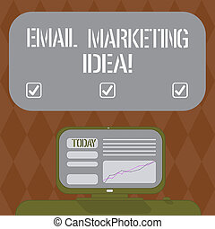 Writing note showing Email Marketing Idea. Business photo showcasing A plan of sending a commercial message to clients Mounted Computer Screen with Line Graph on Desk Blank Color Text Box.
