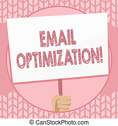 Writing note showing Email Optimization. Business photo showcasing email marketer to maximize the effectiveness of campaign Hand Holding Placard Supported by Handle Social Awareness.
