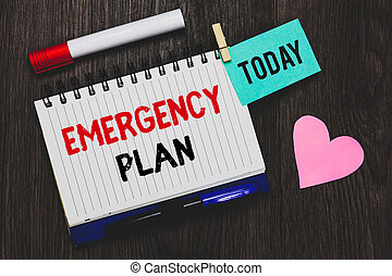 Writing note showing Emergency Plan. Business photo showcasing Procedures for response to major emergencies Be prepared Open notebook pin holding reminder marker heart wooden background.