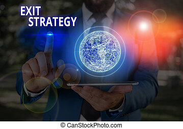 Writing note showing Exit Strategy. Business photo showcasing Extricating oneself from a situation that is become difficult Elements of this image furnished by NASA.