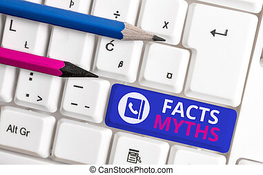 Writing note showing Facts Myths. Business concept for work based on imagination rather than on real life difference White pc keyboard with note paper above the white background