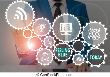 Writing note showing Feeling Blue. Business photo showcasing Feeling of desperation because of sadness or missing someone Male wear formal work suit presenting presentation smart device.