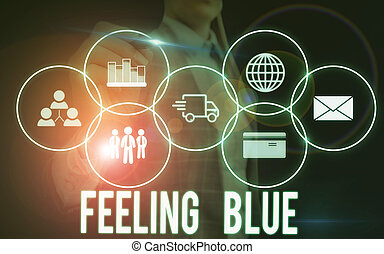 Writing note showing Feeling Blue. Business photo showcasing Feeling of desperation because of sadness or missing someone Woman wear formal work suit presenting presentation using smart device.