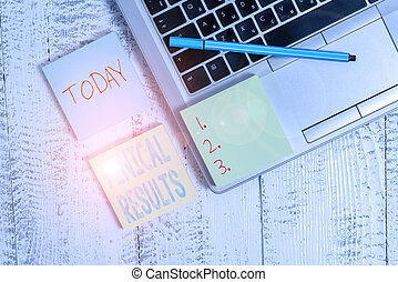 Writing note showing Finical Results. Business concept for written records that convey the business activities Trendy metallic laptop three sticky note pads pen on vintage table desk