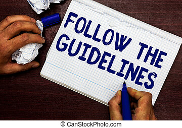 Writing note showing Follow The Guidelines. Business photo...