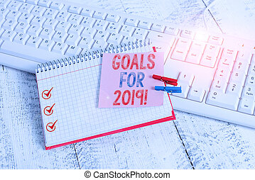 Writing note showing Goals For 2019. Business photo showcasing object of demonstratings ambition or effort aim or desired result notebook reminder clothespin with pinned sheet light wooden.