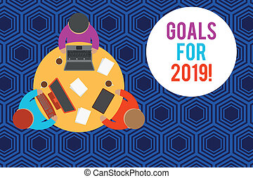 Writing note showing Goals For 2019. Business photo showcasing object of demonstratings ambition or effort aim or desired result Working table male employees electronic devices coffee cup.