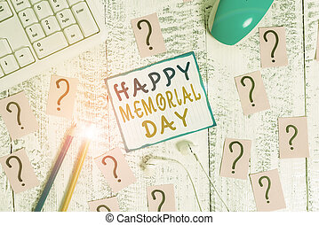 Writing note showing Happy Memorial Day. Business photo showcasing Honoring Remembering those who died in military service Writing tools and scribbled paper on top of the wooden table.