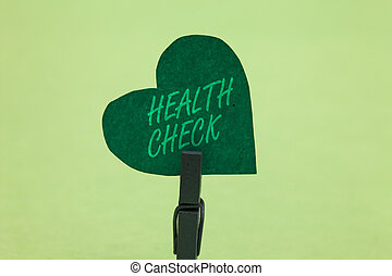 Writing note showing Health Check. Business photo showcasing Medical Examination Wellness and general state Inspection Clothespin holding green paper heart important romantic message ideas.
