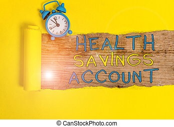 Writing note showing Health Savings Account. Business photo...