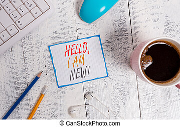 Writing note showing Hello I Am New. Business photo showcasing introducing oneself in a group as fresh worker or student Technological devices colored reminder paper office supplies.